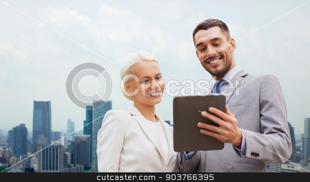 smiling businessmen with tablet pc in city stock photo, business, partnership, technology and people concept - smiling businessman and businesswoman with tablet pc computer over city background by Syda Productions