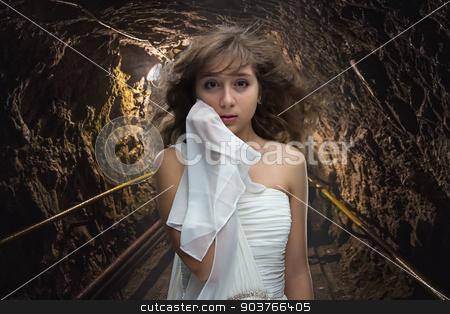 Photo of scared teenage girl  stock photo, Photo of scared teenage girl in cave by Chris Tefme