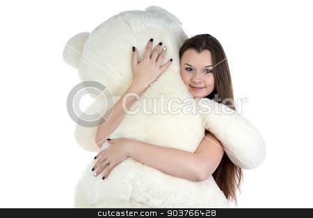 Portrait of hugging teddy bear girl  stock photo, Portrait of hugging teddy bear girl on white background by Chris Tefme