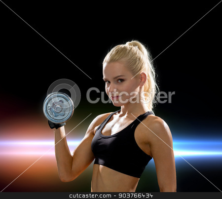 young sporty woman with heavy steel dumbbell stock photo, fitness, healthcare and dieting concept - young sporty woman with heavy steel dumbbell by Syda Productions