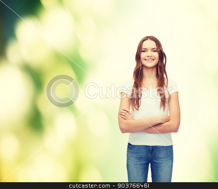smiling teenager in blank white t-shirt stock photo, t-shirt design concept - smiling teenager in blank white t-shirt with crossed arms by Syda Productions