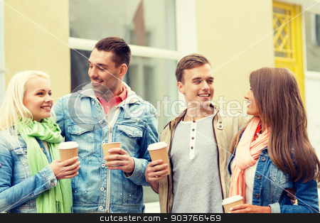 group of smiling friends with take away coffee stock photo, friendship, travel, drink and vacation concept - group of smiling friends with take away coffee by Syda Productions