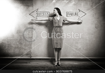 Success - Failure stock photo, young girl against the old wall with graffiti. toned image. by Suchota