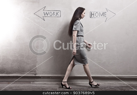 Work - Home stock photo, young girl against the old wall with graffiti. toned image. by Suchota