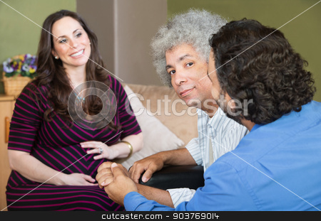 Smiling Surrogate Mother with Gay Couple stock photo, Smiling surrogate mother with gay Hispanic couple by Scott Griessel