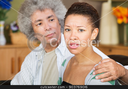 Concerned Woman with Spouse stock photo, Concerned young woman with caring mature husband by Scott Griessel