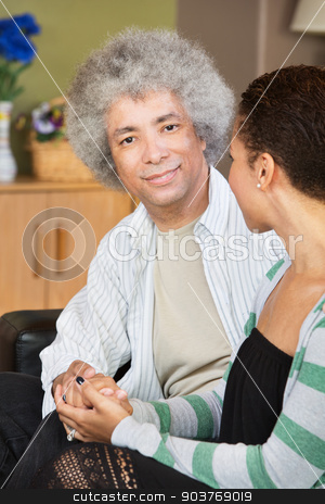 Mixed Age Couple Holding Hands stock photo, Happy mixed young and older couple holding hands by Scott Griessel