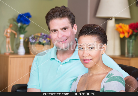 Smiling Couple stock photo, Attractive smiling male and female couple sitting together by Scott Griessel