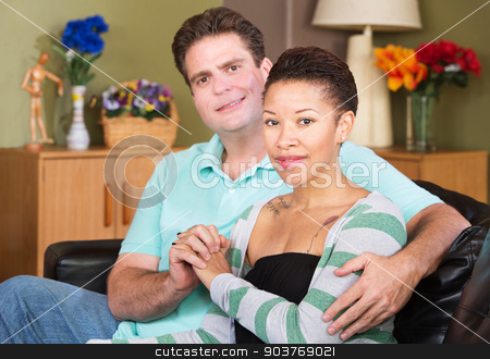 Cheerful Mixed Couple stock photo, Cheerful young mixed Black and White couple holding hands by Scott Griessel