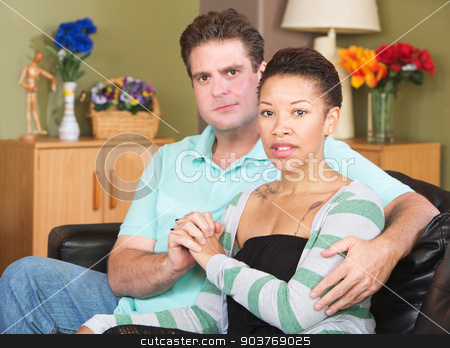 Young Mixed Couple stock photo, Loving mixed European and African couple sitting together by Scott Griessel