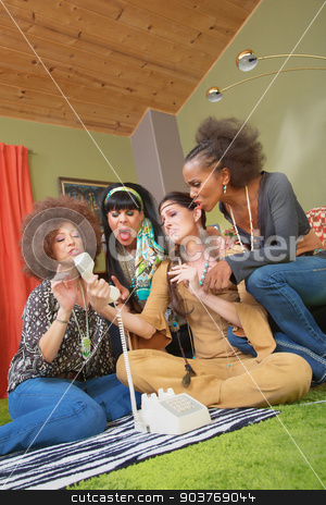 Middle Aged Drunk Women Yelling stock photo, Group of four middle aged retro women yelling at phone by Scott Griessel