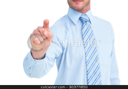 Businessman in shirt pointing with his finger stock photo, Businessman in shirt pointing with his finger on white background by Wavebreak Media