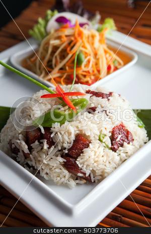 Thai Pork Ribs and Rice Dish stock photo, Traditional dish of freshly prepared Thai food with som tum green papaya salad. by Todd Arena