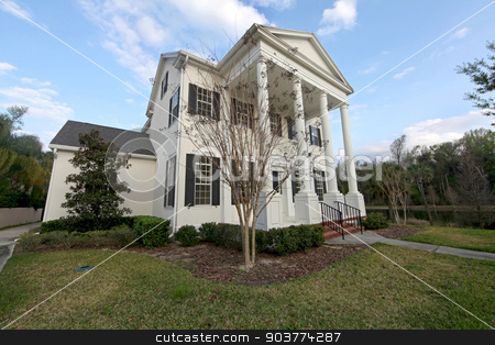 Colonial House stock photo, The front exterior of a home in Florida by Lucy Clark