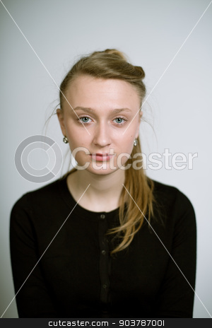 Artistic portrait of a real young girl stock photo, Portrait of a real young woman on a light background in a black cardigan. Shallow depth of field. Focus on the eyelashes.  by Suchota