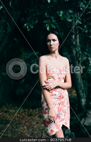 Lady in the dress with a floral pattern stock photo, Portrait of lady in the dress with floral pattern in the Vorontsov Park by Suchota