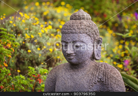 Grinning Stone Buddha stock photo, Close up of grinning stone Buddah statue by Scott Griessel