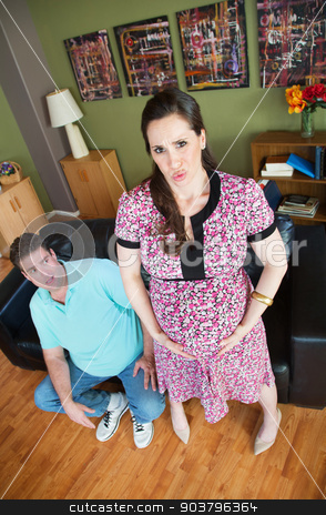 Pregnant Woman with Contractions stock photo, Scared Caucasian husband with pregnant woman having contractions by Scott Griessel