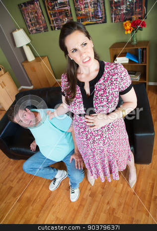 Pregnant Woman Grabbing Man's Collar stock photo, Hostile pregnant woman clenching her boyfriend's collar by Scott Griessel