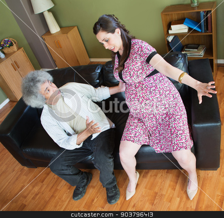Man Trying to Help Pregnant Woman stock photo, Concerned husband helping woman up from sofa by Scott Griessel