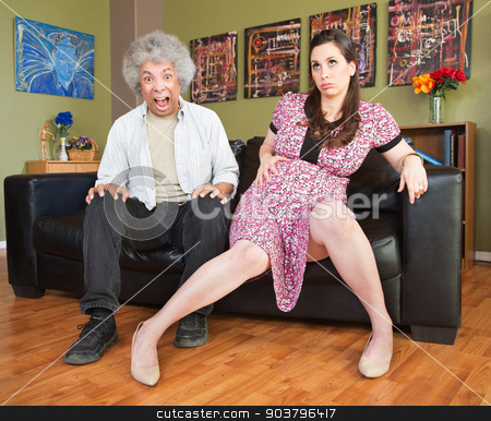 Panicking Man with Pregnant Woman stock photo, Panicking Black man sitting next to pregnant wife by Scott Griessel