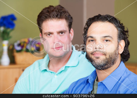 Gay Men Grinning stock photo, Pair of calm homosexual men sitting next to each other by Scott Griessel