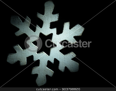 Huge white wooden snowflake and black background. stock photo, Christmas decoration in the form of a wooden snowflake on the black background. by Krzysztof