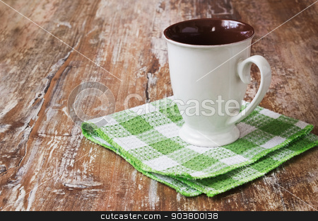 white tea cup stock photo, white tea cup on a kitchen towel on wooden background. dishes and kitchen equipment. copy space background by Jevgeni Proshin