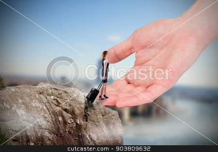 Composite image of redhead businesswoman pulling her suitcase to stock photo, Redhead businesswoman pulling her suitcase to large hand against large rock overlooking foggy city by Wavebreak Media