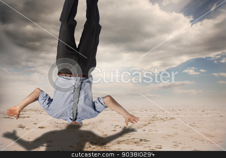 Composite image of businessman burying his head stock photo, Businessman burying his head against cloudy sky background by Wavebreak Media