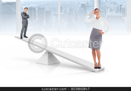 White scales weighing businessman and businesswoman stock photo, White scales weighing businessman and businesswoman in white room overlooking city by Wavebreak Media