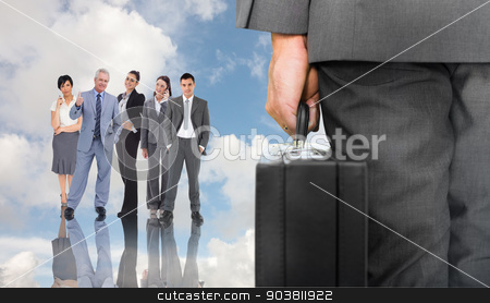 Composite image of businessman holding briefcase stock photo, Businessman holding briefcase against blue sky with white clouds and business people by Wavebreak Media