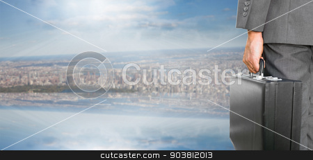 Composite image of businessman holding briefcase stock photo, Businessman holding briefcase against room with large window looking on city by Wavebreak Media