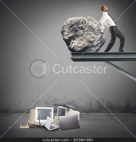 Businessman destroy technology stock photo, Businessman destroy a technology with a stone by Federico Caputo