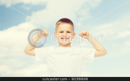 happy little boy in white t-shirt flexing biceps stock photo, advertising, ecology, people and childhood concept - smiling little boy in white blank t-shirt flexing biceps over blue sky background by Syda Productions