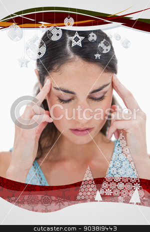 Composite image of portrait of a young woman having a headache stock photo, Portrait of a young woman having a headache against christmas frame by Wavebreak Media