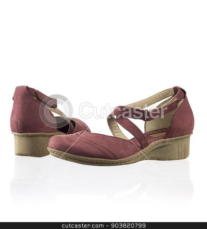 Pair of women shoes stock photo, Pair of modern fashionable women shoes shot in studio by Nikita Buida