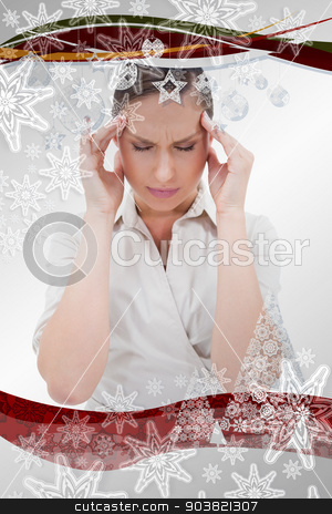 Composite image of portrait of a businesswoman having a headache stock photo, Portrait of a businesswoman having a headache against christmas frame by Wavebreak Media