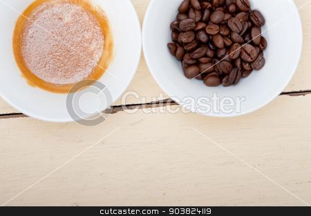 espresso cofee and beans stock photo, italian espresso cofee and beans on a white wood table  by Francesco Perre