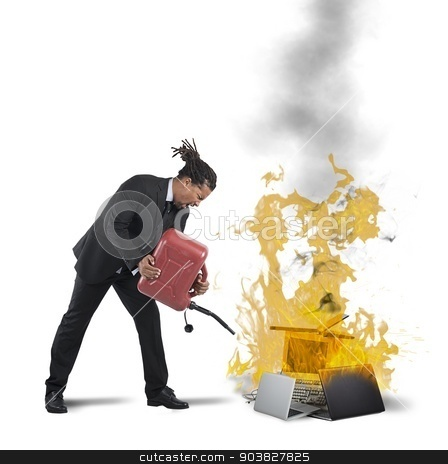 Businessman burns computers stock photo, A businessman stressed and pissed burns computers by Federico Caputo