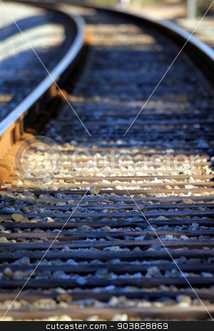 Train Tacks stock photo, Lower view of train tracks with gravel. by Henrik Lehnerer