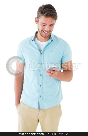 Handsome young man using his smartphone stock photo, Handsome young man using his smartphone on white background by Wavebreak Media