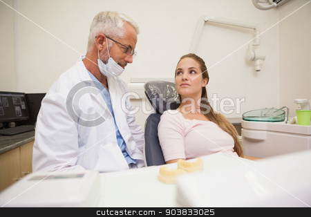 Dentist and patient looking at each other stock photo, Dentist and patient looking at each other at the dental clinic by Wavebreak Media