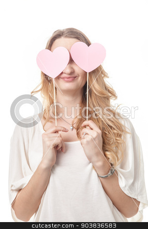 Girl fun posing with two hearts in studio stock photo, Cute lady having fun and posing with two St Valentine hearts in studio by Oleksandr Solonenko