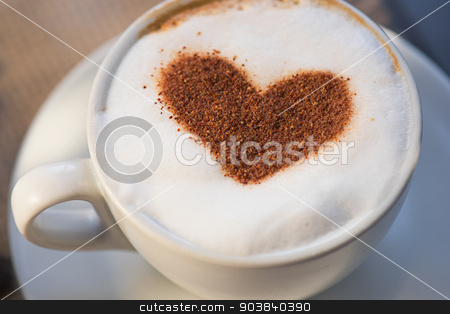 Coffee heart shape stock photo, Coffee cup with milk and heart shape by olinchuk
