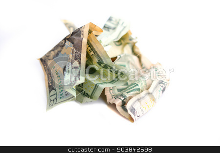 Money Ball stock photo, Money crunched up into a ball on white background. by Henrik Lehnerer