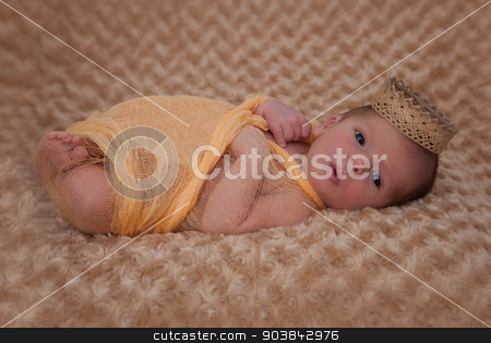 baby wrapped in muslin with crown stock photo, newborn baby wrapped in muslin with crown by mandygodbehear