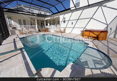 Swimming Pool stock photo, A swimming pool and hot tub at a large home by Lucy Clark