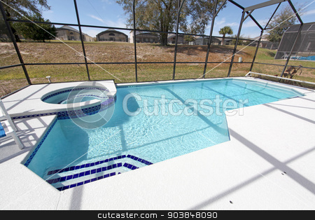 Swimming Pool and Spa stock photo, A swimming pool and spa at a home in Florida by Lucy Clark