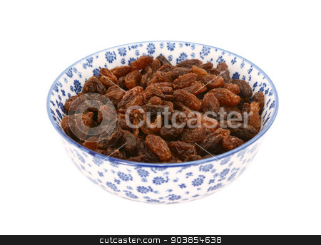 Sultanas in a blue and white china bowl stock photo, Sultanas in a blue and white porcelain bowl with a floral design, isolated on a white background by Sarah Marchant
